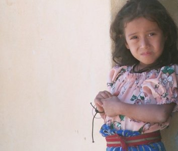 guatemala, picture 1: girl, san pedro. click on the image to go to the next picture